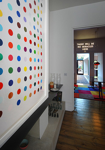 Bright dots on the wall of an interior